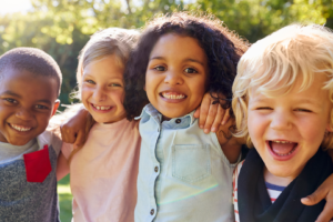 four children smiling at camera