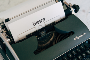 Manual typewriter with 'News' typed on paper