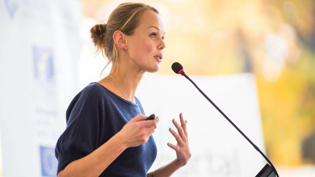 Woman standing at a microphone
