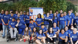 group of young self advocates in blue t-shirts