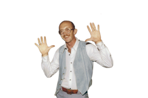 Don Storrs smiling with hands in the air